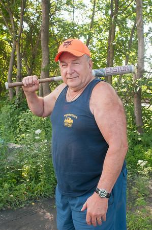 140423 JOED VIERA/STAFF PHOTOGRAPHER-Lockport, NY-Bill Harrington holds his ceramic softball bat over his shoulder on Tuesday July 22nd.
