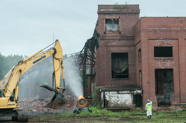 140423 JOED VIERA/STAFF PHOTOGRAPHER-Lockport, NY- EPA Crews tear down the  building on Wednesday July 23rd.