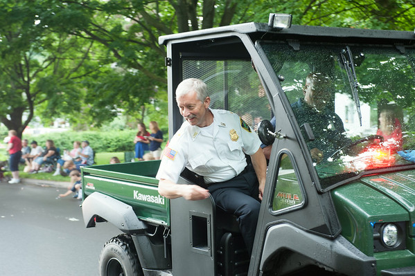 140703 JOED VIERA/STAFF PHOTOGRAPHER-Lockport, NY- Lockport Police Chief Larry Eggert tosses candy to parade goers during the Independance Day Parade on July 3, 2014.