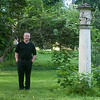 140709 JOED VIERA/STAFF PHOTOGRAPHER-Lockport, NY-Ken Kurns stands next to  a bird feeder in his garden on Tuesday, July 8th. Kurbs is all but ready for Lockport's Garden Walk this weekend. .