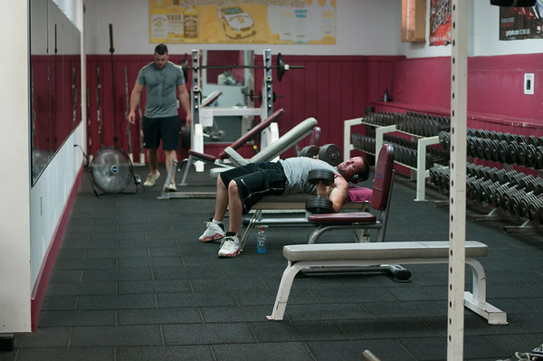 14010 JOED VIERA/STAFF PHOTOGRAPHER-Lockport, NY-Men workout at Ultimate Physique on Thursday, July 10th.