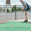 140416 JOED VIERA/STAFF PHOTOGRAPHER-Lockport, NY-Alaina Wagner plays a round of miniature golf at Allie Brandt Lanes on Wednesday July 16th.