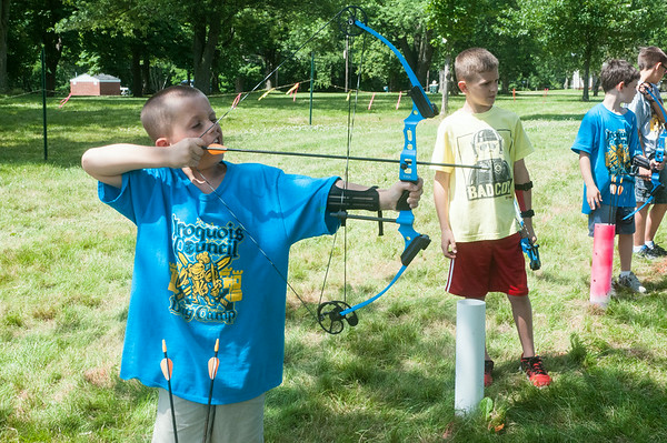 140709 JOED VIERA/STAFF PHOTOGRAPHER-Lockport, NY-Cubs Scouts Bryan Schicker 8 and Cole Ganz 8 hit targets with bows and arrows during the annual Iroquois Trail Council day camp Wednesday, July 9th.