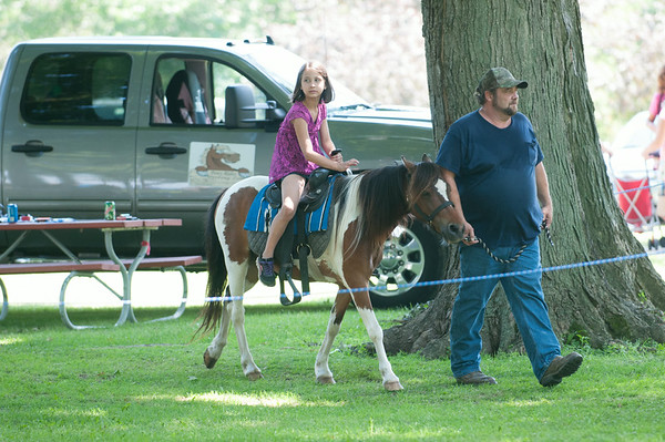 14012 JOED VIERA/STAFF PHOTOGRAPHER-Olcott, NY- Michayla Greene 8 enjoys a pony ride at Olcott's Annual Pirates Fest on Saturday, July 12th.