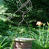 140709 JOED VIERA/STAFF PHOTOGRAPHER-Lockport, NY-Flowers bloom next to a sculpture in Ken Kurbs' garden on Tuesday, July 8th. Kurbs is all but ready for Lockport's Garden Walk this weekend. .
