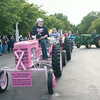 140430 JOED VIERA/STAFF PHOTOGRAPHER-Lockport, NY-Kim Kennedy leads the Tractor Parade with her Mother in Law Debbie Kennedy's Pink Tractor at the Niagara County Fair on Wednesday July 30th.