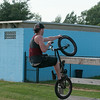 140702 JOED VIERA/STAFF PHOTOGRAPHER-Lockport, NY-Travis Farnsworth performs a tire grab at Outwater Park's skate park. July 1, 2014.
