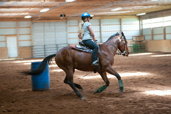 140702 JOED VIERA/STAFF PHOTOGRAPHER-Lockport, NY-Camper Ashley Randall rides her horse Frank during horse riding camp at the Lockport Fairground on July 2, 2014.