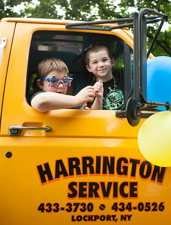 140703 JOED VIERA/STAFF PHOTOGRAPHER-Lockport, NY-Kids pass out candy from a truck during the Independance Day Parade on July 3, 2014.