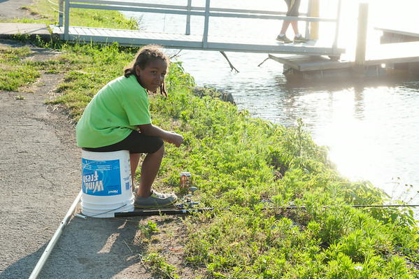 140702 JOED VIERA/STAFF PHOTOGRAPHER-Lockport, NY-Jamar Swanson waits for a tug on his fishing rod during the Erie Canal Fishing Derby on July 2, 2014.