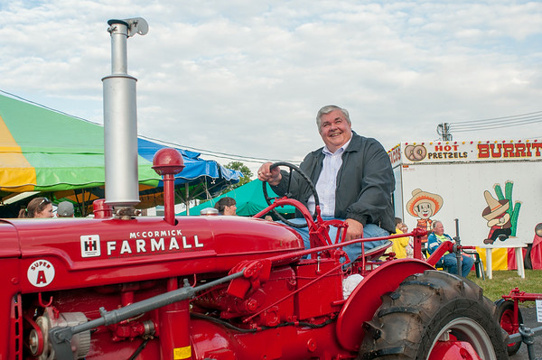 140430 JOED VIERA/STAFF PHOTOGRAPHER-Lockport, NY-Wayne Jatow participates in the Tractor Parade at the Niagara County Fair on Wednesday July 30th.