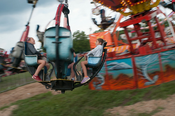 140430 JOED VIERA/STAFF PHOTOGRAPHER-Lockport, NY-A man drives his tractor to the Niagara County Fair on Thursday July 31st.