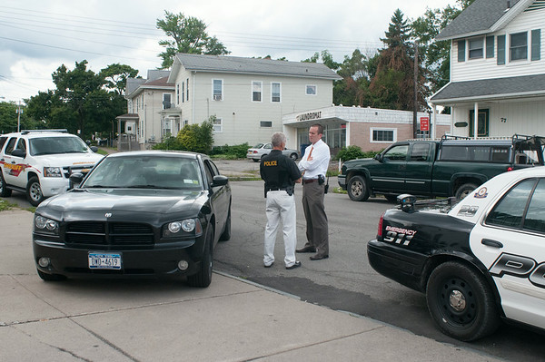 140429 JOED VIERA/STAFF PHOTOGRAPHER-Lockport, NY-LPD Chief Larry Eggert speaks to a detective outside of M&T Bank after a robbery on Tuesday July 29th.