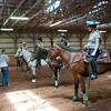 140702 JOED VIERA/STAFF PHOTOGRAPHER-Lockport, NY-Instructor Adele Beatty gives tips to Campers (from left) Joslynn Bull, Taylor Porter, Samantha Lippert and Ashley Randallduring horse riding camp at the Lockport Fairground on July 2, 2014.