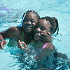 140415 JOED VIERA/STAFF PHOTOGRAPHER-Lockport, NY-Brooklynn Cunningham 10 and Mayia Lee 12 swim at Lockport's Community Pool on Tuesday, July 15th.