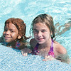 140415 JOED VIERA/STAFF PHOTOGRAPHER-Lockport, NY-Best friends Emily Kathke 9 and Abby houghton 10 swim at Lockport's Community Pool on Tuesday, July 15th.