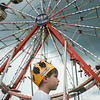 140430 JOED VIERA/STAFF PHOTOGRAPHER-Lockport, NY-Julian Updegraph looks up at a ride at the Niagara County Fair on Thursday July 31st.