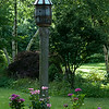 140709 JOED VIERA/STAFF PHOTOGRAPHER-Lockport, NY-Flowers bloom next to a bird feeder in Ken Kurbs' garden on Tuesday, July 8th. Kurbs is all but ready for Lockport's Garden Walk this weekend. .