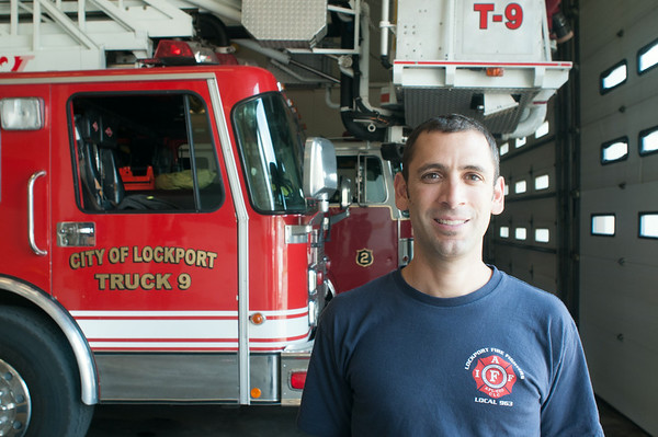 140423 JOED VIERA/STAFF PHOTOGRAPHER-Lockport, NY- stands in front of a fire truck at the Lockport Fire Department on Wednesday July 23rd.