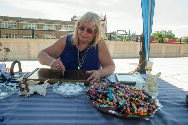 14012 JOED VIERA/STAFF PHOTOGRAPHER-Lockport, NY-Phillis Abbey a Medium, delivers a crayon reading at Lockport's community market on Saturday, July 12th.