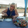 14012 JOED VIERA/STAFF PHOTOGRAPHER-Lockport, NY-Phillis Abbey a Medium, delivers a crayon reading at Lockport's community market on Saturday, July 12th.