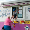 140709 JOED VIERA/STAFF PHOTOGRAPHER-Lockport, NY-Megan Gamin from Pete's Treats serves her regular customer Frances Earl a twist cone on Wednesday, July 9th.