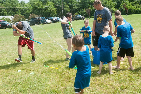 140709 JOED VIERA/STAFF PHOTOGRAPHER-Lockport, NY-Cubs Scouts enjoy a water war during the annual Iroquois Trail Council day camp Wednesday, July 9th.