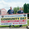 140423 JOED VIERA/STAFF PHOTOGRAPHER-Lockport, NY- stand behind a banner for Community Day at the Lockport Fire Department on Wednesday July 23rd.