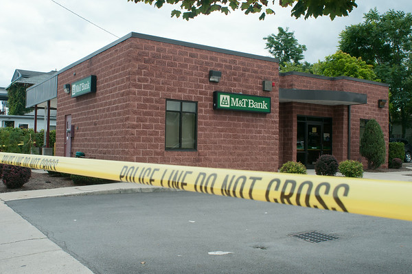 140429 JOED VIERA/STAFF PHOTOGRAPHER-Lockport, NY-Police tape blocks the perimeter of M&T Bank after a robbery on Tuesday July 29th.