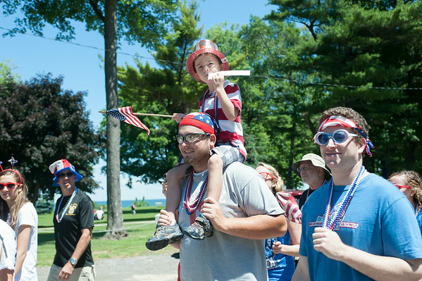 140704 JOED VIERA/STAFF PHOTOGRAPHER-Olcott, NY-Matt Riggi carries Calvin Matton (6) on his shoulder  during Olcott's Independance Day parade  on July 4, 2014.