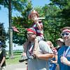 140704 JOED VIERA/STAFF PHOTOGRAPHER-Olcott, NY-Matt Riggi carries Calvin Matton (6) on his shoulder  during Olcott's Independance Day parade  on July 4, 2014.