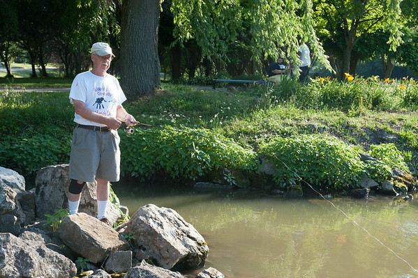 140702 JOED VIERA/STAFF PHOTOGRAPHER-Lockport, NY-George Williams fishes along the canal on July 2, 2014.