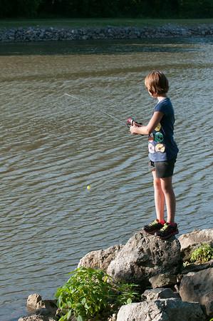 140702 JOED VIERA/STAFF PHOTOGRAPHER-Lockport, NY-McKenna Koch fishes along the canal on July 2, 2014.