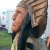 140430 JOED VIERA/STAFF PHOTOGRAPHER-Lockport, NY-A wooden sculpture of an Chief and a bear Matt Hass of Sawdogs made with his chainsaw at the Niagara County Fair on Thursday July 31st.