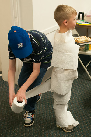 140430 JOED VIERA/STAFF PHOTOGRAPHER-Lockport, NY-Joshua Poeller 12 wraps up Greg Treutlein 7 as a mummy during  Egyptian Day at the Niagara County History Center on Wednesday July 30th.