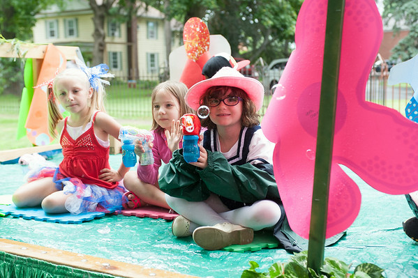 140703 JOED VIERA/STAFF PHOTOGRAPHER-Lockport, NY-Girls blow bubbles off of a float during the Independance Day Parade on July 3, 2014.