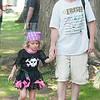 14012 JOED VIERA/STAFF PHOTOGRAPHER-Olcott, NY- Dave  Kirkpatrick walks with his daughter Kelsie at Olcott's Annual Pirates Fest on Saturday, July 12th.