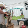 140430 JOED VIERA/STAFF PHOTOGRAPHER-Lockport, NY-Matt Hass of Sawdogs chainsaws wood into a sculpture at the Niagara County Fair on Thursday July 31st.