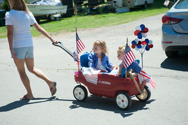 140704 JOED VIERA/STAFF PHOTOGRAPHER-Olcott, NY-Roberta Faery strolls her daughters Andrea (4) and Gracie in a radio flyer during Olcott's Independance Day parade  on July 4, 2014.
