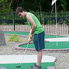 140416 JOED VIERA/STAFF PHOTOGRAPHER-Lockport, NY-Aaron Wagner plays a round of miniature golf at Allie Brandt Lanes on Wednesday July 16th.