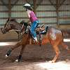 140702 JOED VIERA/STAFF PHOTOGRAPHER-Lockport, NY-Camper Joslynn Bullget rides her horse Katie during horse riding camp at the Lockport Fairground on July 2, 2014.