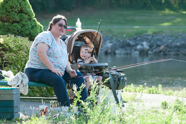 140702 JOED VIERA/STAFF PHOTOGRAPHER-Lockport, NY-Tristin Laubacker 2 and his grandmother Pauline Laubacker fish along the canal during  the Erie Canal Fishing Derby on July 2, 2014.
