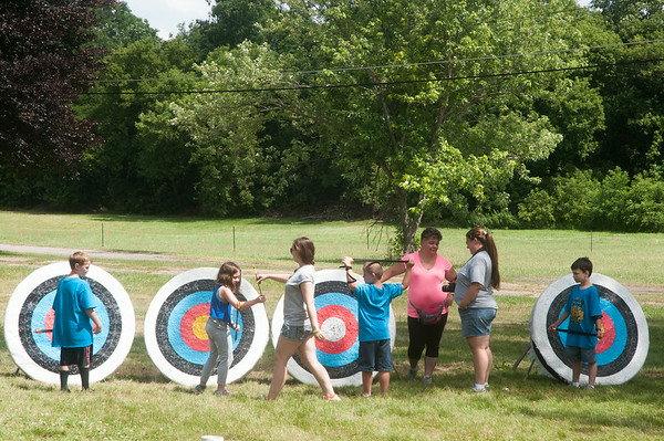 140709 JOED VIERA/STAFF PHOTOGRAPHER-Lockport, NY-Cubs Scouts hit targets with bows and arrows during the annual Iroquois Trail Council day camp Wednesday, July 9th.