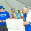 (From left to right) Jeff Degano, Damon Olds and Brad Lombard prepare for a team dinner served by John Newton (right) following Sunday's victory for the Terre Haute Rex.