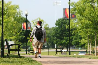 A GWU student walking towards Tucker Student Center during Jumpstart.