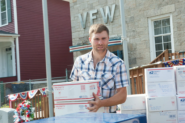 140630 JOED VIERA/STAFF PHOTOGRAPHER-Lockport, NY-Robert Farnham helps bring boxes to a truck at the VFW on June 30, 2014