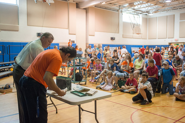 140611 Time Capsule JOED VIERA/STAFF PHOTOGRAPHER-Ransomville, NY- the crowd watches as Principal Michael Cancilla(right) and Superintendent  Michael Wendt(left) open a 1939 time capsule at W.H. Stevenson. June 11, 2014