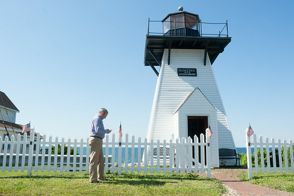 140627 JOED VIERA/STAFF PHOTOGRAPHER-Olcott, NY- PHOTO ILLUSTRATION-Jason Mollica checks out a audio description of Olcott Beach's Lighthouse on his phone.