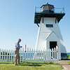 140627 JOED VIERA/STAFF PHOTOGRAPHER-Olcott, NY- PHOTO ILLUSTRATION-Jason Mollica checks out a audio description of Olcott Beach's Lighthouse on his phone.