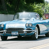 140630 JOED VIERA/STAFF PHOTOGRAPHER-Lockport, NY-A man rides his classic corvette down the Market Street hill on June 30, 2014.